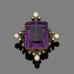 An amethyst and diamond brooch The scissor-cut amethyst framed by old brilliant-cut diamond and pearl scrolls. Art Deco.