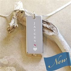 Custom Name Engraved pendant for discreetly and securely holding a lock of hair or ashes.   Beautifully engraved with a loved one's name and a heart on the front.