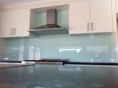 Soft blue glass kitchen back splash