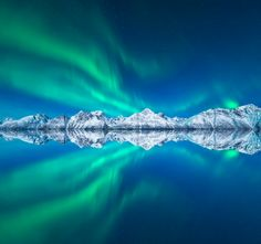 """""""Aurora and Reflection; photo by Tor-Ivar Naess - In honor of the return of aurora season to Earth's northerly latitudes, here's the aurora borealis – northern lights – above Norway's Lyngen Alps."""
