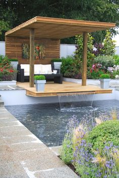 This plunge pool utilizes a patio to create a waterfall.  What a great use of a small space!