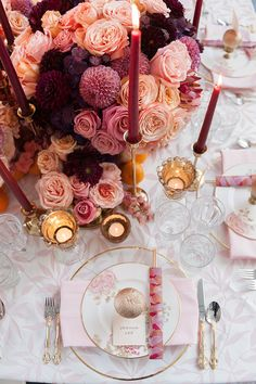 Beautiful orange, dark purple and pink coloured flowers beside the soft warm glow of candles // While 2017's Pantone Colour Of The Year symbolised new beginnings, Ultra Violet looks toward the future. With this in mind, the team behind Formosa Events sought to create a contemporary oriental-inspired table setting for the modern couple. Hand painted details and lush floral arrangements add a feminine touch to this styled shoot, captured by Pepper and Light.