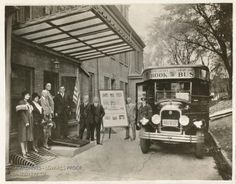 "President-elect Franklin D. Roosevelt with the Queens Borough (N.Y.) Public Library ""book bus"" in 1930."