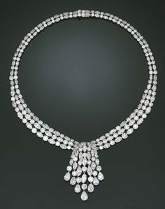 A DIAMOND NECKLACE, BY GRAFF    The front section designed as three rows of marquise and circular-cut diamonds with a central cascade terminating in pear-shaped diamonds, to the similarly-set diamond two-row backchain, mounted in platinum, 39.0 cm
