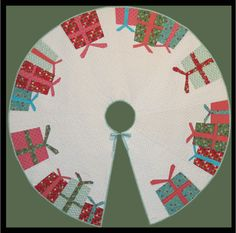 Do you love paper piecing and the holidays? If yes, this Christmas Tree Skirt pattern is for you! Pattern available at http://quiltwoman.com/All-I-Want-For-Christmas-Tree-Skirt-Pattern.aspx