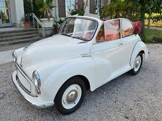 My car in England is a1967 cream Morris Minor with red leather seats, but not a Convertable like this one..