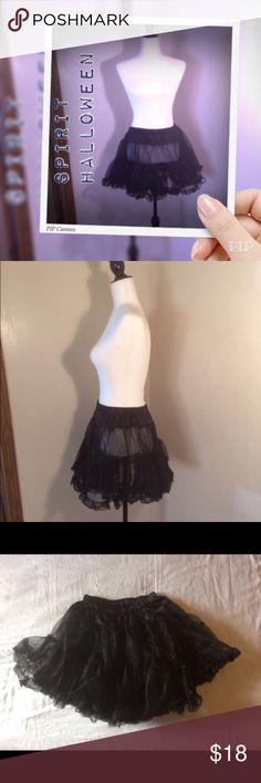 "NIB Spirit Halloween deluxe black petticoat NIB Spirit Halloween deluxe black petticoat one size fits most. This petticoat is new in package and never been worn, but it was stored away so the package is a little bent. Approximate measurements laying flat are 17"" length and 18"" waist. Made of a super stretchy material. Goes great with any dress you want to make fuller! Spirit Halloween Other"