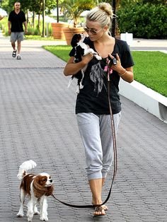 Julianne Hough walking Lexi and holding puppy Harley on her walk.