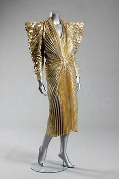 Terry Mugler Cloth of Gold 1987 - this piece sold at Kerry Taylor auctions on July 26, 2012.  Sold for L6600 ($10,296 USD)