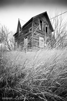 Low angle view of an old farm house in Prince Edward County, Ontario, Canada