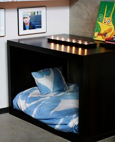 Bedroom Nightstand Ideas: Two Ikea tables were put together to create a modern dog bed that also functions as a nightstand. What a fabulous way to keep your furry friends comfy and next to you at night.