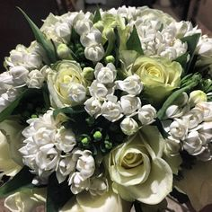 Bridal bouquet with white roses and white bouvardia .