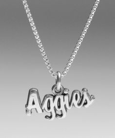 """A wonderfulsterling silver necklace for your loved one. It is an 18"""" chain with the word """"Aggies"""" in cursive at the bottom."""