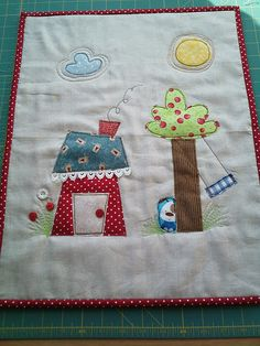 House mini quilt -love the stitching around the sun and cloud and the lace trim along the roof