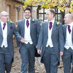 Stuart and his grooms party hired suits from Moss Bros because of their wide variety of matching accessories, and trendy styles available in-store. The handkerchiefs and cravats matched the colour of the bridesmaids dresses perfectly, and from the minute Laura and Stuart walked in to the store, the staff couldn't have been more helpful.The suits were grey with ivory waistcoats underneath. The men wore black shoes to match and a tails style jacket for the occasion.