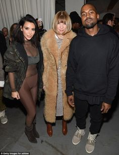 Design by Kanye: The happy trio posed for a snap - with Kim's attire being the most daring