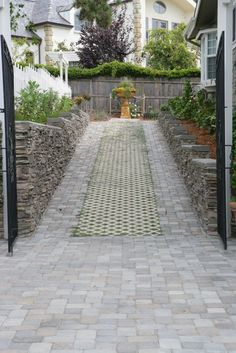 Driveway with pavers and grass.
