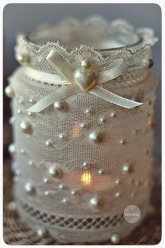 Shabby Chic Luminaires - using lace, ribbon, beads and glue, plain jars get a facelift. These would be great for a wedding or for Christmas - via Vekoria