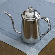 Stainless Steel Pour Over Kettle: This mirror finished 18-10 stainless steel kettle features a drip-free spout design. It's perfect for a clean pourover for manual coffee brewing, or for brewing loose leaf tea. A very attractive presentation for guests, with a minimal footprint. 24oz capacity, good for 1-4 cup pourovers. Brand: Pearl Horse.