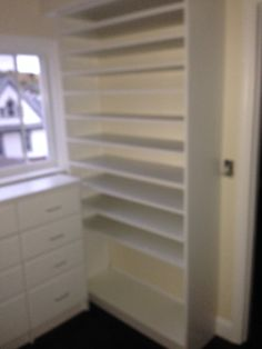 Shoe shelves tucked behind drawer storage ensured that every inch of this room was used for efficient storage.  Another happy customer!