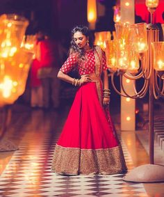 We loved how bride teamed a plain red lehenga with gold accents with an all over embroidered crop top for her Reception at Jag Mandir Island Palace, Udaipur. Indian Wedding Lehenga, Bridal Lehenga, Indian Bridal, Lehenga Style, Red Lehenga, Lehenga Choli, Lehenga Blouse, Lehenga Skirt, Patiala Salwar