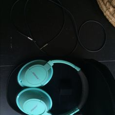 Bose Teal Around-Ear Headphones Comes with case and cord. Little wear showing, but it doesn't effect quality at all. Urban Outfitters Other