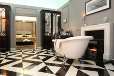 Gatsby's bathroom featured Stone Emporium's black and white checkerboard tiles, Sonas sanitary ware, and a smart bathroom unit crafted by MJ Clooney.