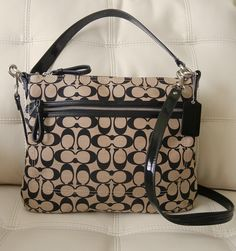 This Elegant, Modern Silhouette is Crafted in Bold Signature Fabric with Decorative Stitching and Soft, Rounded Corners. A Bit of Chain-Link Hardware Adds Subtle Glamour to its Versatile Crossbody Design. The Patent Leather Adds Chic Shine! Three Words Classic, Classic, Classic!!!. This Handbag W...