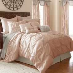 Adorn your bedroom with this luxurious and complete bed in a bag set. With the warm, muted beige, blush, or grey color options and classic pin-tuck style, this bedroom set contains everything you need