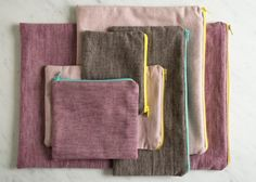 Simple Lined Zipper Pouches | The Purl Bee. Note the orientation of the zipper on the short edge of the larger bag; perfect for holding knitting needles.