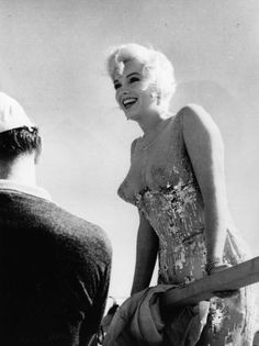 "Marilyn Monroe in ""Some like it hot"".Wardrobe by Orry-Kelly (Oscar winner).'59.The dress looks like Monroe is not wearing a dress at all.Made of nude chiffon lining,the top is sheer,other than a few silver & white appliqués strategically placed.Monroe wears no bra & the back of the dress falls into a deep V.O-K fit MM's dresses by tying a string around her legs just where her bottom ended so he knew where the fabric should cling & then sewed the garment onto her."