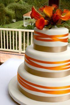 Orange wedding cake no gold purple plz ribbon and flowers