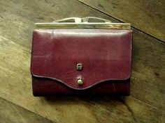 ♥ vintage Etienne Aigner oxblood leather wallet ...classic styling in sturdy dark reddish brown leather...the front flap secures with a brass stud