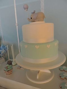 Pretty cake at an elephant baptism party! See more party planning ideas at CatchMyParty.com!