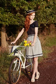 100% cotton eyelet, gathered skirt with roomy adorable pockets and grosgrain ribbon details. This skirt is a perfect summer skirt. It's airy and light.