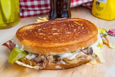 Cuban Grilled Cheese, Finally, something that will melt your icy heart. Recipe here.