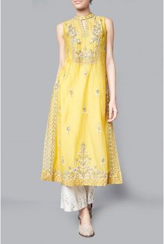 Exquisite, light fabrics and intricate tonal embroideries blend in the Ayneera Tunic. This sleeve-less yellow chanderi tunic is a perfect addition to your summer wardrobe. A symphony of pastel shades of summer and motifs borrowed from woods and gardens, Songs of Summer is an ode to ballads of nature. Style Tip: Wear the top with a tulle skirt or embroidered culottes. Add to your ensemble, our Pearl drop earrings and embroidered mojris. Fabric: CHANDERI MULL Content: 70% COTTON / 30% SIL...