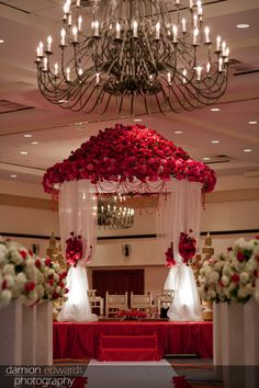 Indian Wedding Altar, The Mandap stage was created with 6000 flowers and fabrication to make the design flow.