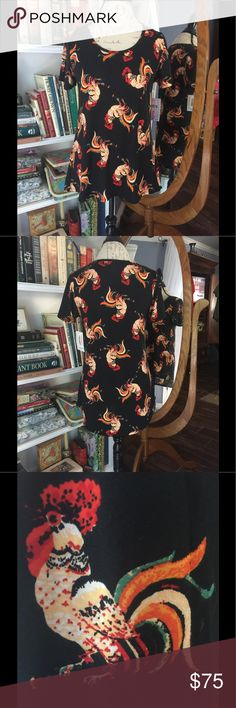 NWT LuLaRoe small rooster classic tee Have to destash! NWT unicorn hard to find rooster chicken small classic tee. Red orange yellow green white cream on black background. Can downsize 1-2 sizes on tee. I bought because I love it and want to keep but haven't worn yet, so if you don't like the high price, I'm sorry.   Please check out my other quality listings. All sales final. Will consider reasonable offers only. Cross posted.   Tags: rose animals carly maxi perfect tee tunics nicole pants…