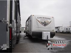 Used 2013 Prime Time RV LaCrosse 318BHS Travel Trailer at Western RV Country | Leduc, AB | #16RD162A