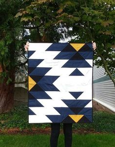 This patchwork quilt was inspired by native american indian art and crafts. It is made from cotton fabric and lightweight cotton batting. The colors in this quilt are dark blue, black, yellow and white. The backing part is gray. Colchas Quilting, Quilting Projects, Quilting Ideas, Quilting Patterns, Boys Quilt Patterns, Beginner Quilting, Beginner Quilt Patterns, Patchwork Patterns, Quilting Tutorials