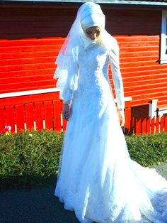 Love the way the hijab is worn with this bridal dress