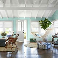 This beach house incorporates different shades of blue to reflect the many colours of the ocean. Beautiful don't you think? #beachcottagestyledecor