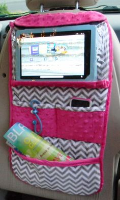 A IPad or tablet holder, in grey and white chevron with pink trim, for teens and children which hangs on the back of the seat. by berniea64 on Etsy