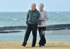 Japanese Emperor Akihito (L) and Empress Michiko (R) stroll around the imperial villa in Hayama, in Kanagawa prefecture south of Tokyo on February 7, 2013.  The emperor and empress arrived here on February 7 for a rest until February 10.   AFP PHOTO / KAZUHIRO NOGI        (Photo credit should read KAZUHIRO NOGI/AFP/Getty Images)