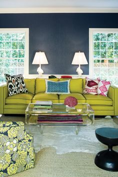 Gray Blue Walls with White Trim + Green Couch + White Lamps + Sunlight