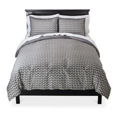 Crisp, clean and modern, the Chevron Herringbone Duvet Set in gray from Threshold is the perfect finishing touch for a bedroom or guest room. With a gray and white all-over herringbone print, this bedding set is understated but stylish and easy to coordinate with bright colors or neutral decor. Available in queen/full or king sizes and comes complete with a duvet cover and 2 pillow shams.