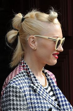 Gwen Stefani wears her signature stacked balls-o'-hair styles at a party hosted by Joel Silver.