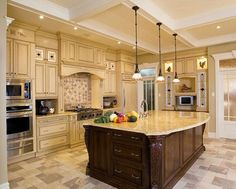 Gorgeous kitchen design with mix of cabinet finishes and unique ceiling treatment! | www.HomeChannelTV.com #kitchendesigns