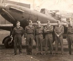 """""""A group of pilots on a Boulton Paul Defiant Squadron pose with their Squadron Mascot at RAF Driffield."""""""